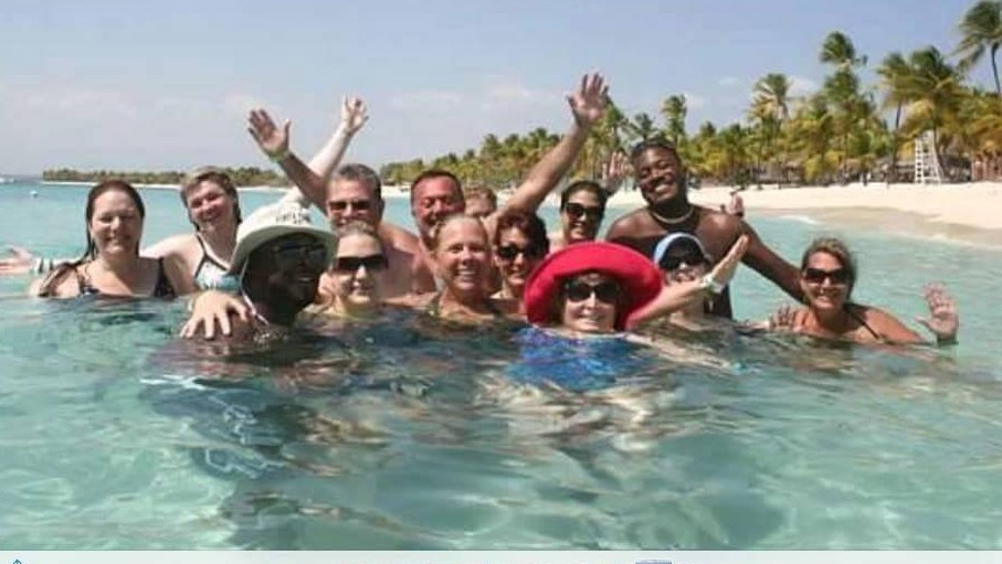 Enjoying the crystal clear water of Punta Cana with my team